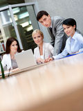 Business people discuss current matters Royalty Free Stock Images