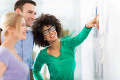 Business people discuss data on board stock photography