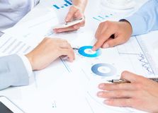 Business people discuss meeting targets Stock Photos