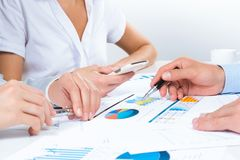 Business people discuss meeting targets Stock Photography