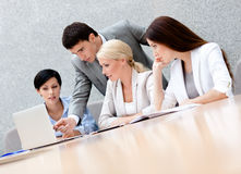 Business people discuss the plan. Business people discuss something at the meeting at the modern office building. Leadership Royalty Free Stock Photography
