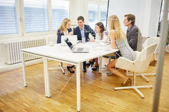 Business people discuss together a strategy Stock Photo