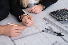 Business People Discussing A Architectural Drawing Royalty Free Stock Photo