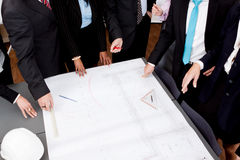 Business people discussing architecture plan sketch Stock Photos