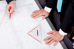 Business people discussing architecture plan sketch Stock Photo