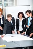 Business people discussing architecture plan sketch Stock Images