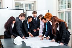 Business people discussing architecture plan sketch Royalty Free Stock Image