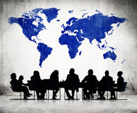 Business People Discussing Around The Conference Table. And A Blue Cartography Of The World Above stock illustration