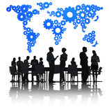 Business People Discussing And A Blue Cartography Stock Photos