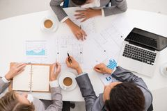 Business people discussing blueprint stock photo