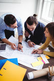 Business people discussing on blueprint Stock Photo