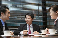 Business People Discussing At Cafe Table Royalty Free Stock Photo