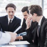 Business people discussing charts Stock Images