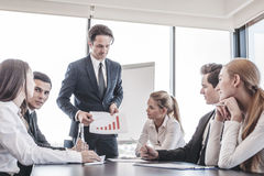 Business people discussing charts Royalty Free Stock Images
