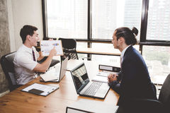 Business people discussing the charts and graphs showing the results. Royalty Free Stock Photos
