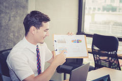 Business people discussing the charts and graphs showing the results. Stock Images