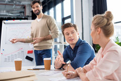 Business people discussing charts and statistics on small office meeting Stock Images