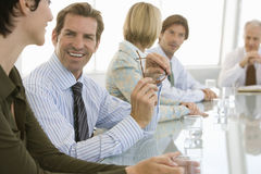 Business People Discussing In Conference Room Royalty Free Stock Photos