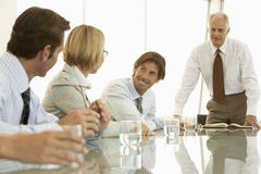 Business People Discussing In Conference Room Stock Photography