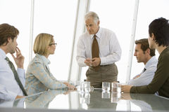 Business People Discussing In Conference Room Stock Photo