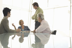 Business People Discussing In Conference Room Stock Image