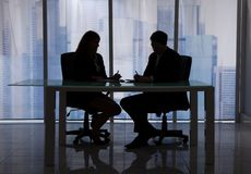 Business people discussing at desk in office Stock Photos