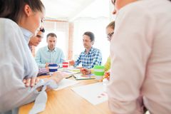 Business people discussing financial matter stock photography