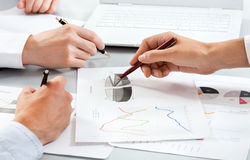 Business people discussing a financial plan Stock Photos