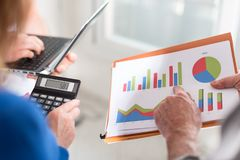 Business people discussing about financial results Royalty Free Stock Images