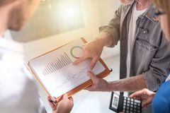 Business people discussing about financial results, light effect Stock Images