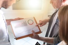 Business people discussing about financial results, light effect Stock Photos