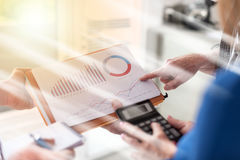 Business people discussing about financial results, light effect Stock Image
