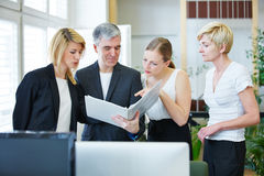Business people discussing Stock Photography