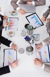 Business People Discussing On Graph At Conference Table Royalty Free Stock Photo
