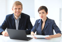 Business people discussing ideas at meeting using laptop Stock Photography