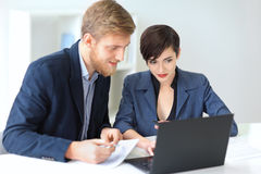 Business people discussing ideas at meeting using laptop Royalty Free Stock Photography