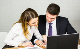 Business people discussing ideas at meeting using laptop in the office. Royalty Free Stock Photos
