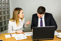 Business people discussing ideas at meeting using laptop in the office. Stock Images
