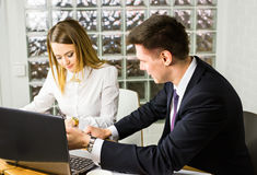 Business people discussing ideas at meeting using laptop in the office. Royalty Free Stock Images