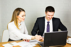 Business people discussing ideas at meeting using laptop in the office. Stock Photo