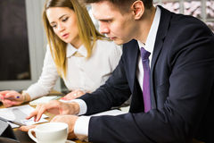 Business people discussing ideas at meeting using laptop in the office. Royalty Free Stock Photography