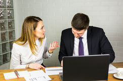 Business people discussing ideas at meeting using laptop in the office. Stock Photos