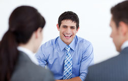 Business people discussing at a job interview. Smiling business people discussing at a job interview in the office