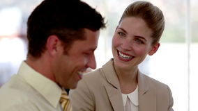 Business people discussing and laughing. At the office stock footage