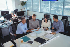 Business people discussing in meeting at office desk Stock Images