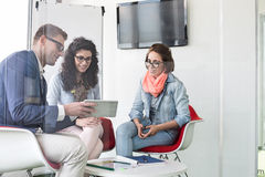Business people discussing in meeting room royalty free stock image
