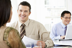 Business People Discussing In Office Royalty Free Stock Images