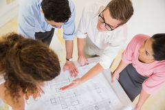 Business people discussing over blueprint Stock Image