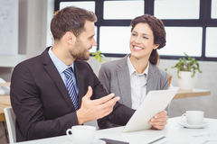 Business people discussing over digital tablet Stock Images