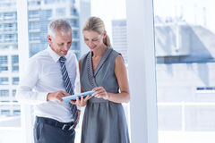 Business people discussing over a digital tablet Stock Photo